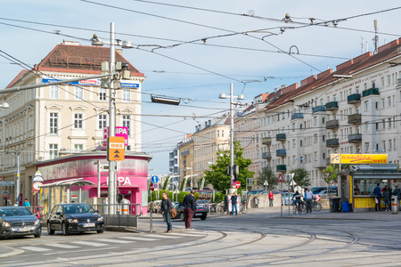 streetscene: Street scene with people and traffic on Fasanplatz in Landstrasse district of Vienna, Austria