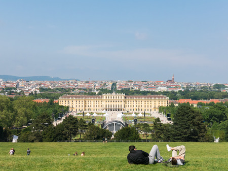 gloriette: People on lawn of Gloriette and panoramic view of Schonbrunn Palace Gardens and the city of Vienna, Austria