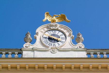 Top of west facade with clock and ornaments, Schonbrunn Palace in Vienna, Austria Editorial