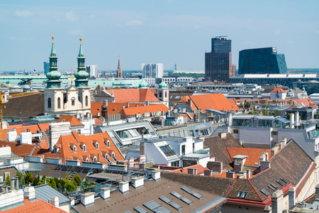 wien: Panorama with Jesuit Church, City Tower and Wien Mitte building from north tower of St. Stephens Cathedral in Vienna, Austria