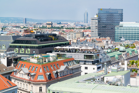 flak: Panorama with rooftop cafe, Flak Towers, Millennium Tower and Raiffeisen House off north tower of St. Stephens Cathedral in Vienna, Austria