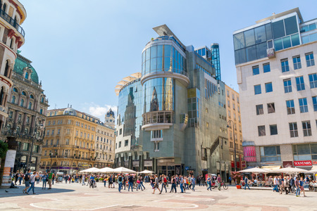 streetscene: People and Haas House on Stephansplatz in the city centre of Vienna, Austria