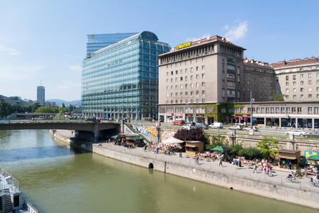 streetscene: Highrise and waterfront promenade of Little Danube canal in city of Vienna, Austria