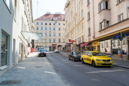 streetscene: Taxi stand and police car parked in Laurenzerberg street in downtown Vienna, Austria Editorial