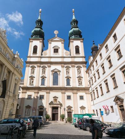 streetscene: Jesuit Church or University Church on Ignaz Seipel Platz in Vienna, Austria Editorial