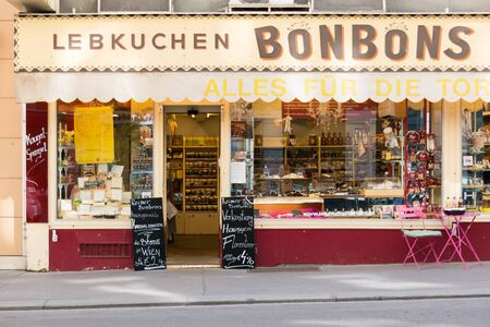 candy store: Front facade of Viennese candy store with display of sweets and chocolates in inner city of Vienna, Austria