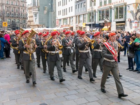 streetscene: Marching brass band in procession on Stephansplatz in Vienna on Corpus Christi holiday, Austria