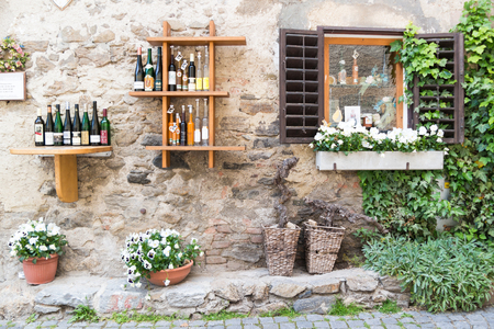 Display of wine bottles outside liquor store in Main Street of old town Durnstein in Wachau valley, Lower Austria