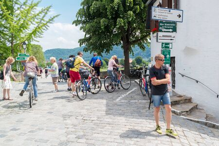 main street: People on vacation with bicycles in Main Street of old town Durnstein in Wachau valley, Lower Austria
