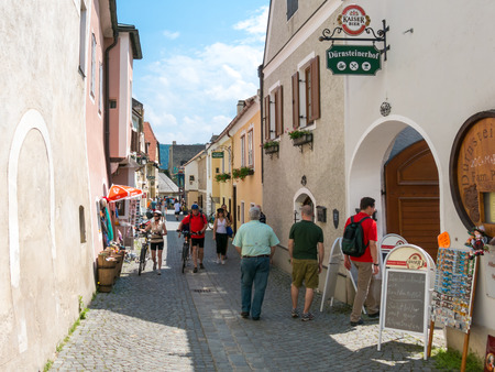 main street: People walking and shopping in Main Street of old town Durnstein in Wachau valley, Lower Austria