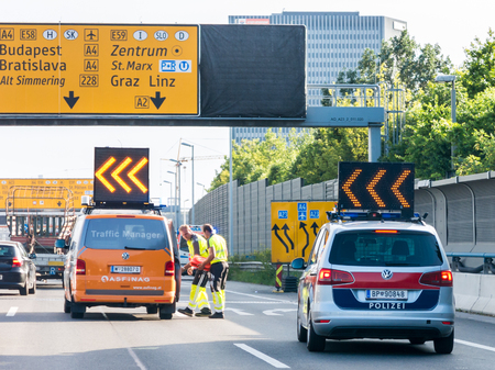 emergency lane: Emergency services police and traffic manager after car accident on highway in Vienna Editorial