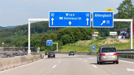 Traffic and direction signs on Autobahn motorway A1 in Lower Austria near Vienna, Austria