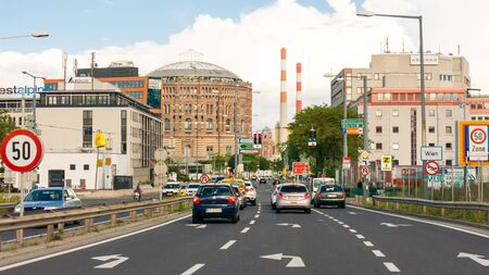 streetscene: Traffic on Doblerhofstrasse near Gasometer City in Simmering district in Vienna, Austria