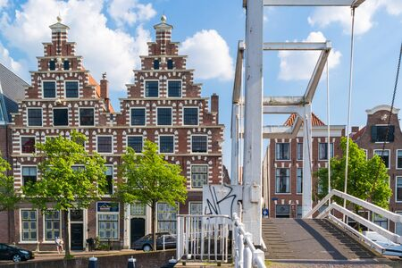stepped: Stepped gables of old brewery Olyphant and Gravestenen drawbridge over Spaarne river in Haarlem, Netherlands
