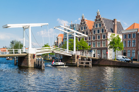 gables: Gravestenen drawbridge over Spaarne river and stepped gables of old brewery Olyphant in Haarlem, Netherlands