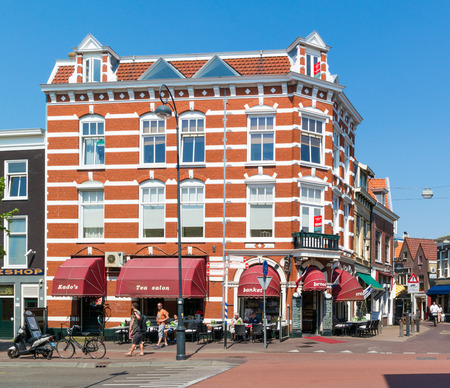 streetscene: Corner of Kleine Houtstraat and Gedempte Oude Gracht with coffee shop and people in city of Haarlem, Netherlands Editorial