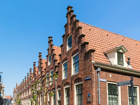 gables: Row stepped gables of old houses in Groot Heiligland street in old town of Haarlem city in Holland, Netherlands Editorial