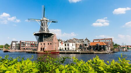 benelux: Old mill Adriaan and Spaarne river panorama in Haarlem, Holland, Netherlands
