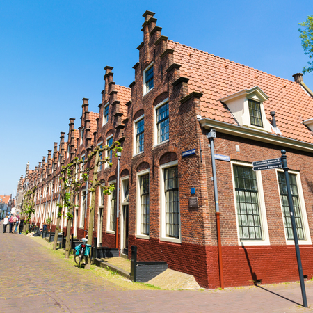 Row of houses with stepped gables in Groot Heiligland street in old town of Haarlem, Holland, Netherlands