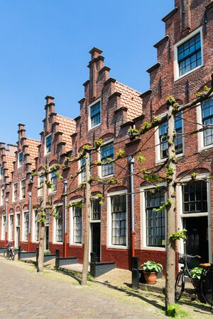 gables: Row houses with stepped gables in Groot Heiligland street in old town of Haarlem, Holland, Netherlands Editorial