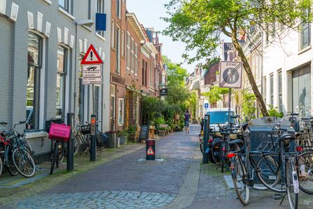 streetscene: Parked bicycles and flexible bollard for vehicle access control in Breestraat street in city centre of Haarlem, Netherlands Editorial