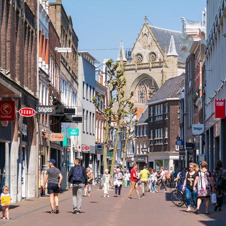 streetscene: People walking in shopping street Grote Houtstraat in downtown Haarlem, Holland, Netherlands