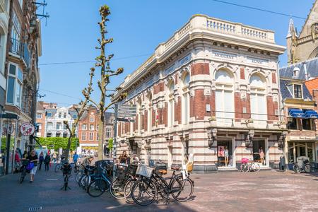 Grote Houtstraat street scene with people and Verweyhal of Museum De Hallen in downtown Haarlem, Holland, Netherlands