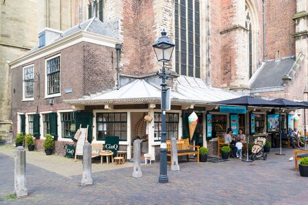 streetscene: Street scene of Lepelstraat with people and coffee shop in old town of Haarlem, Holland, Netherlands