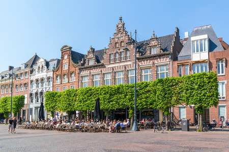 streetscene: People relaxing on sidewalk cafe on Grote Markt market square in city centre of Haarlem, Holland, Netherlands Editorial