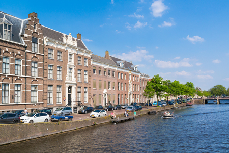 episcopal: View of Nieuwe Gracht canal with boat and Episcopal Palace in downtown Haarlem, Holland,  Netherlands