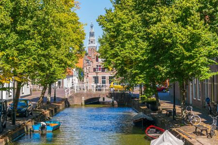 Baangracht canal with trees and boats in Alkmaar, North Holland, Netherlands