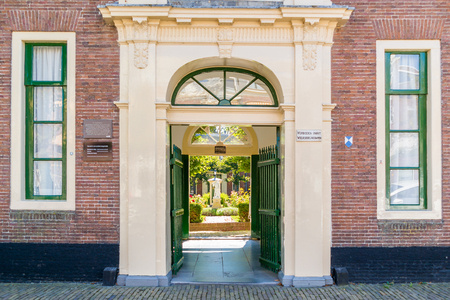 north holland: Entrance gate of courtyard Wildemanshofje in Alkmaar, North Holland, Netherlands