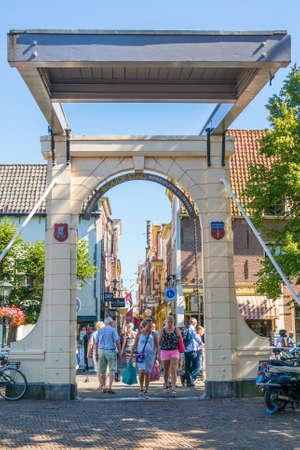 draw bridge: People walking on Bathbrug bridge to shopping street Fnidsen in Alkmaar, Netherlands