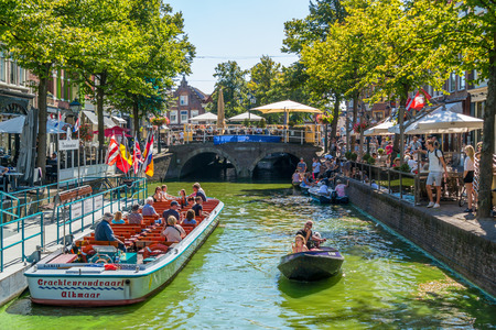 north holland: People and tourist boat on Mient canal in Alkmaar, North Holland, Netherlands