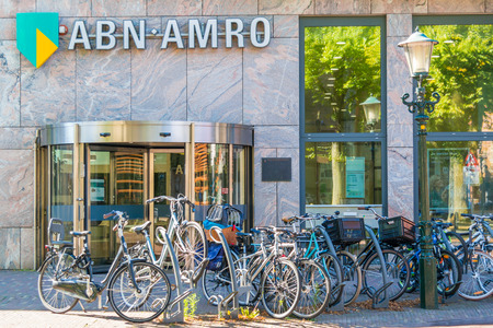 north holland: ABNAMRO bank branch office with parked bicycles in Alkmaar, North Holland, Netherlands