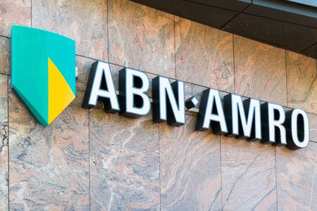 north holland: Brand name logo ABN AMRO bank on local branch office in Alkmaar, North Holland,  Netherlands