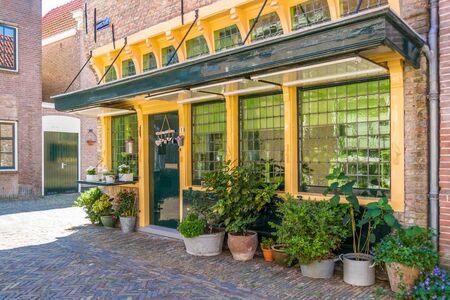 corner house: Facade of old shop in Kanisstraat in Alkmaar, North Holland, Netherlands