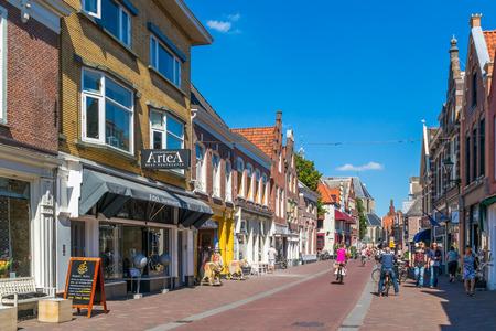 People and shops in shopping street Ritsevoort in Alkmaar, North Holland, Netherlands
