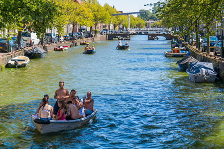 north holland: People enjoying and relaxing on boats on Oudegracht canal in Alkmaar, North Holland, Netherlands