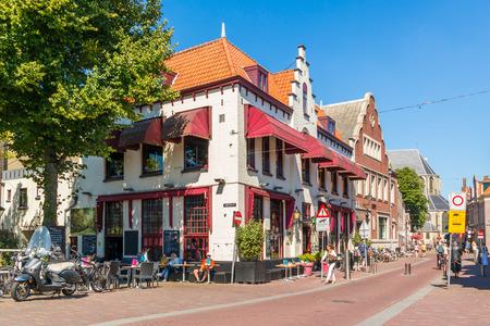 streetscene: Street scene of corner Lindegracht and Koorstraat with people on outdoor cafe terrace in Alkmaar, Netherlands