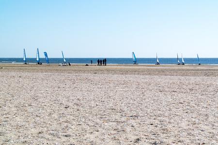 ijmuiden: People sailing on land yachts on beach at North Sea coast in IJmuiden, Netherlands
