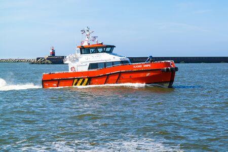 ijmuiden: Crew transfer catamaran Njord Snipe for offshore windfarms entering seaport IJmuiden near Amsterdam, Netherlands