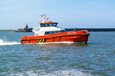 Crew transfer catamaran Njord Snipe for offshore windfarms entering seaport IJmuiden near Amsterdam, Netherlands