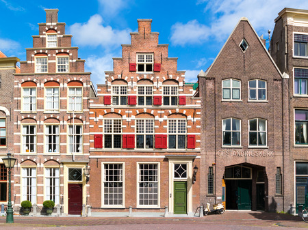 house gables: Row of historic gables on Steenschuur canal in old town of Leiden, South Holland, Netherlands Editorial