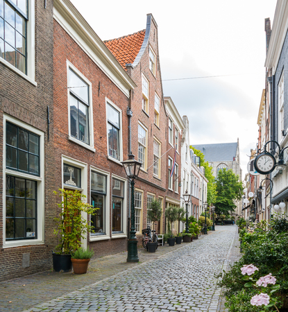 Historic houses in narrow street Kloksteeg in old town of Leiden, South Holland, Netherlands