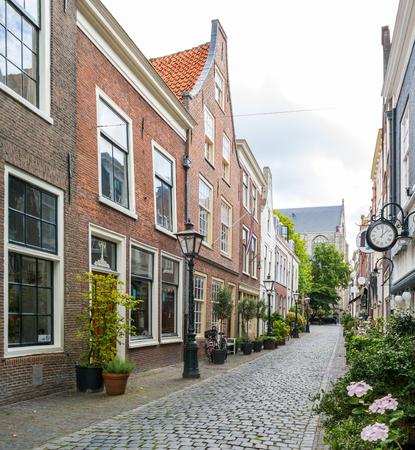 streetscene: Historic houses in narrow street Kloksteeg in old town of Leiden, South Holland, Netherlands