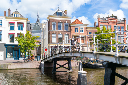 Bridge over New Rhine canal and gables of historic houses in old town of Leiden, South Holland, Netherlands