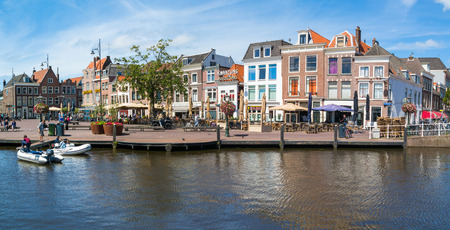 dinghies: Houses and cafes on Beestenmarkt from Singel canal in old town of Leiden, South Holland, Netherlands