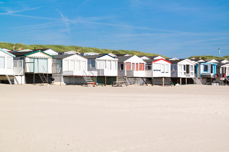 houses row: Row of beach houses or huts on IJmuiden beach at North Sea coast in Netherlands