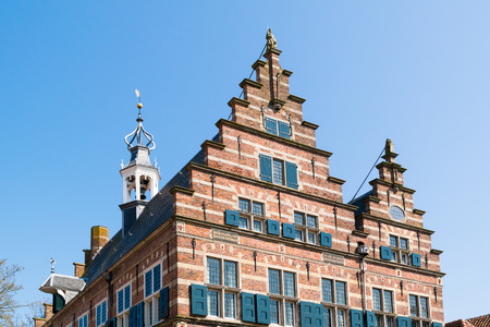 Top facade of town hall with stepped gables in old town of Naarden, North Holland, Netherlands Editorial